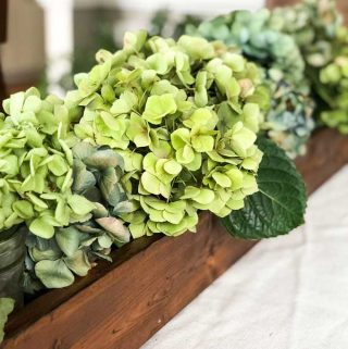 dried hydrangeas in a wooden trough