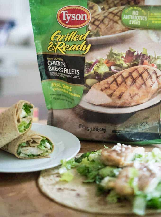 chicken caesar wrap on white plate with bag of tyson grilled chicken