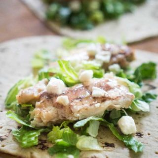 chicken caesar wrap on tortilla before folding