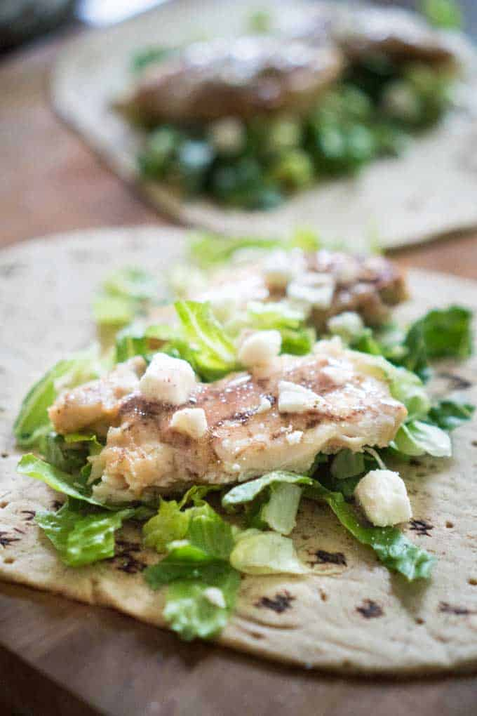 chicken caesar wrap on tortilla before folding