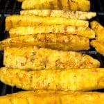 close up of pineapple spears on grill