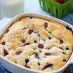 berry buttermilk cake in white square casserole dish