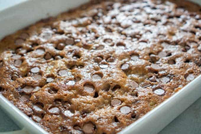 Chocolate Chip Banana Bars close up in white casserole dish