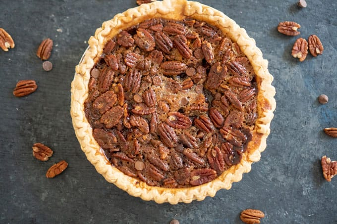 Chocolate Pecan Pie  on slate counter with pecan halves