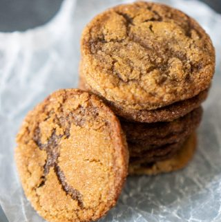 stack of Homemade Gingersnaps on parchment paper