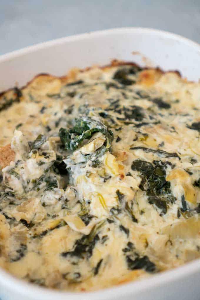 Best Spinach Artichoke Dip in a white casserole dish
