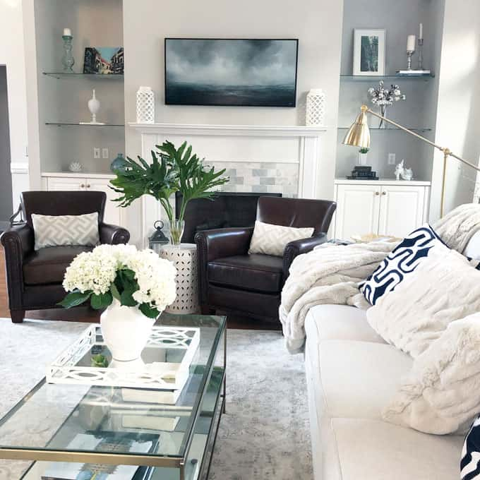neutral living room with marble fireplace surround