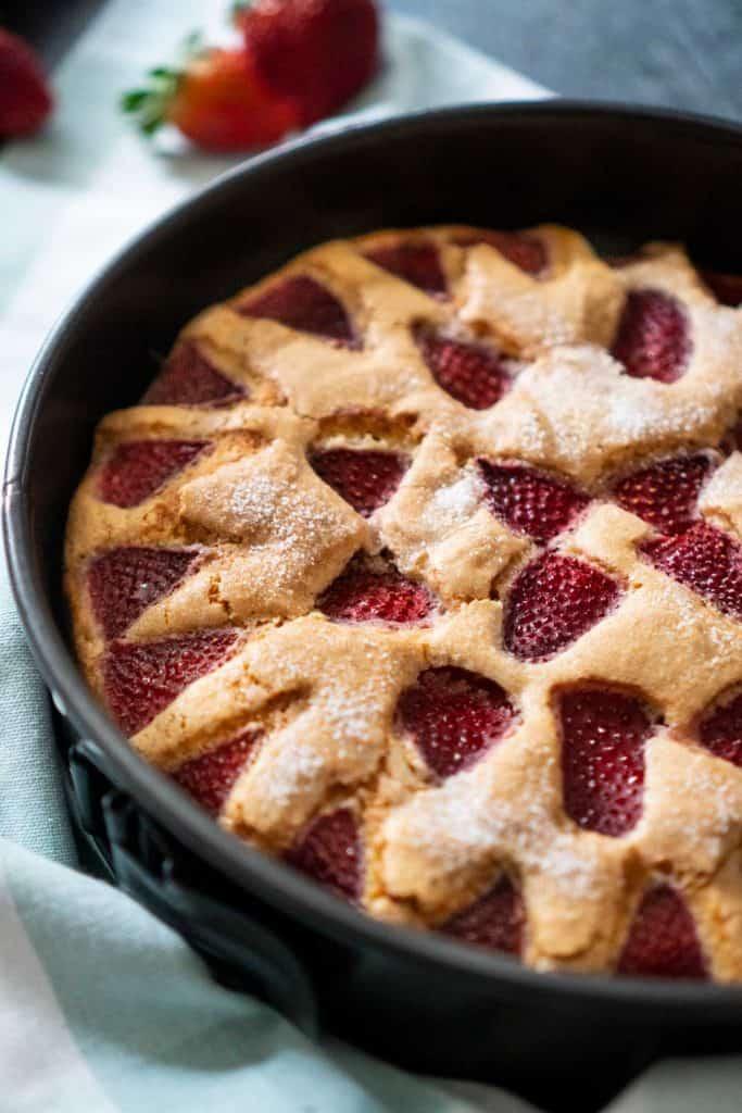strawberry cake in dark pan