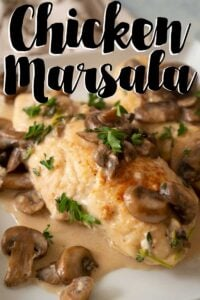 chicken marsala on plate with mushrooms and herbs and text overlay of Chicken Marsala