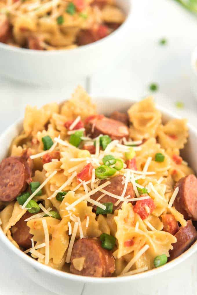 spicy sausage pasta in white bowl