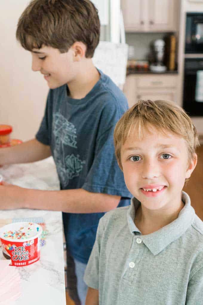 little boys with single serve ice cream cup