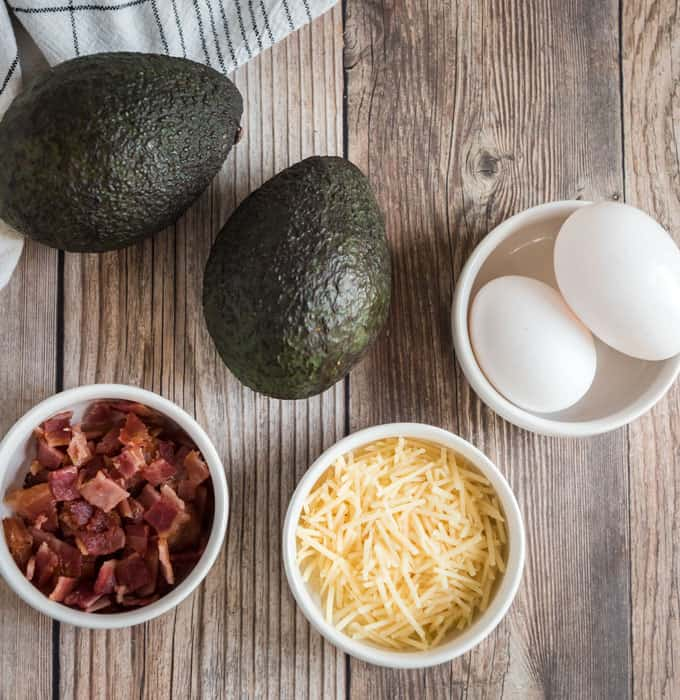 avocados, eggs, bacon crumbles and shredded cheese