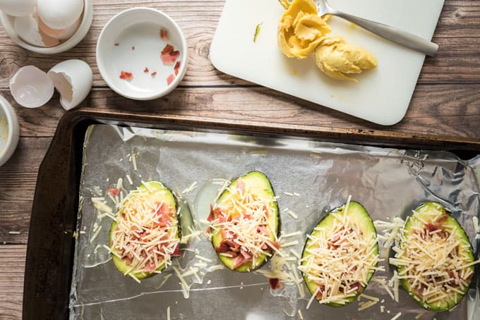 avocado halves with egg cheese and bacon