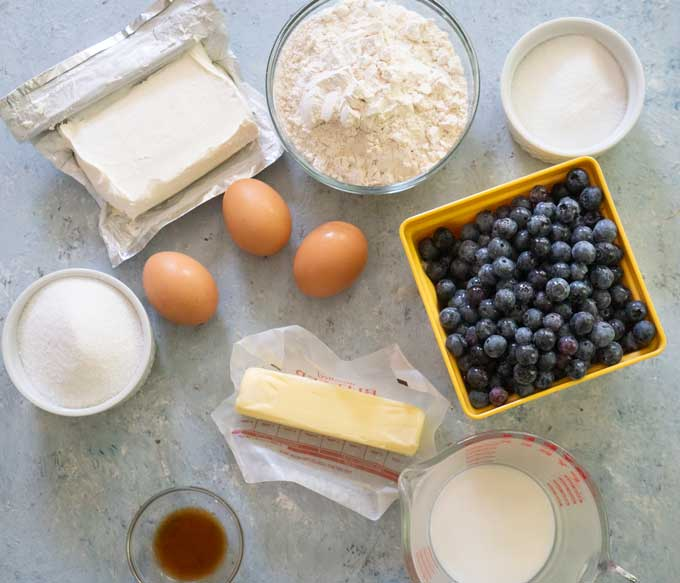ingredients for blueberry bread on blue background