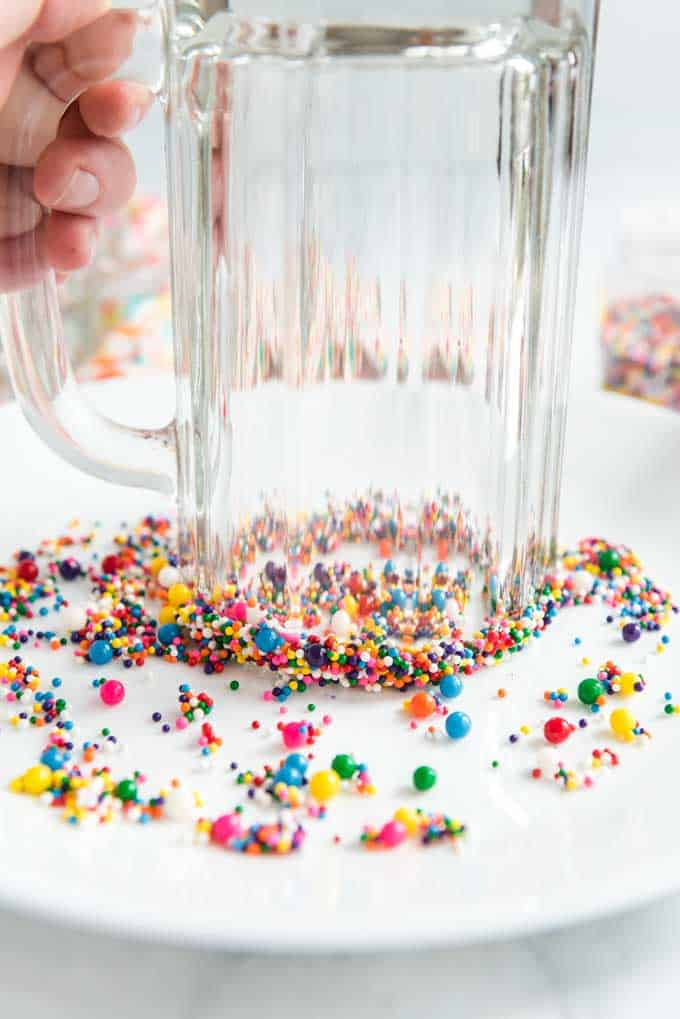 rimming a glass with cake sprinkles
