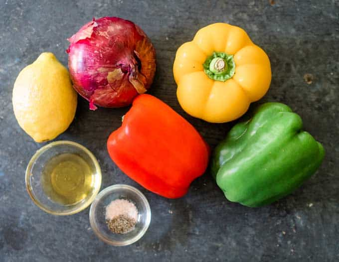 red, yellow, and green bell peppers with red onion lemon olive oil and salt and pepper
