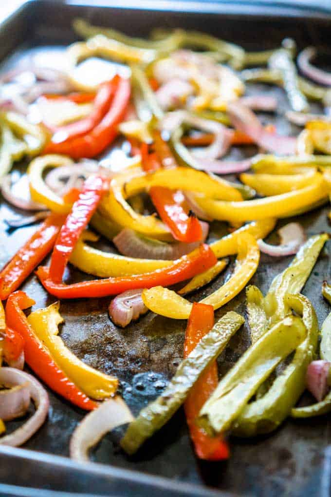 roasted bell peppers and onions on baking sheet