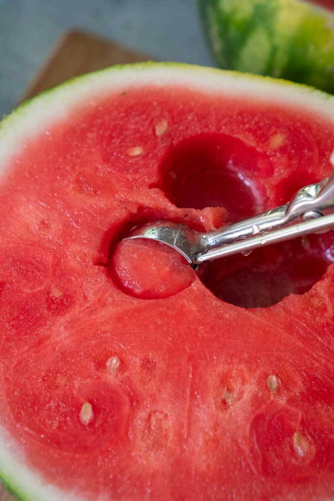 scooping watermelon with melon baller