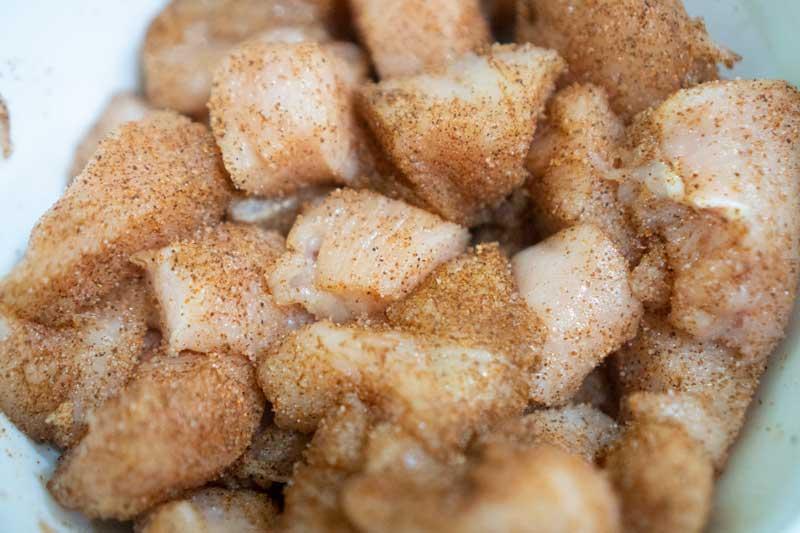 chicken breast cut into pieces with cajun seasoning