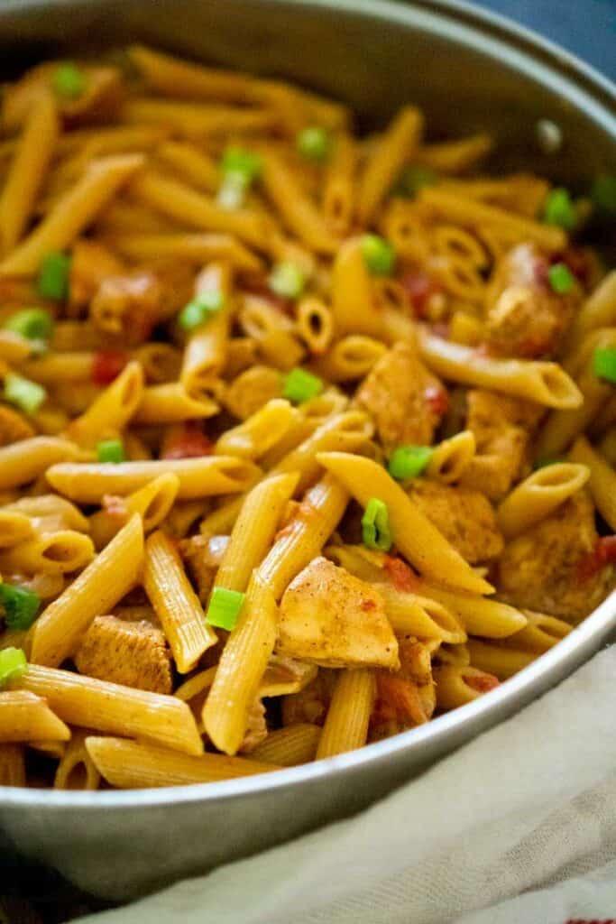 creamy cajun chicken penne pasta in skillet