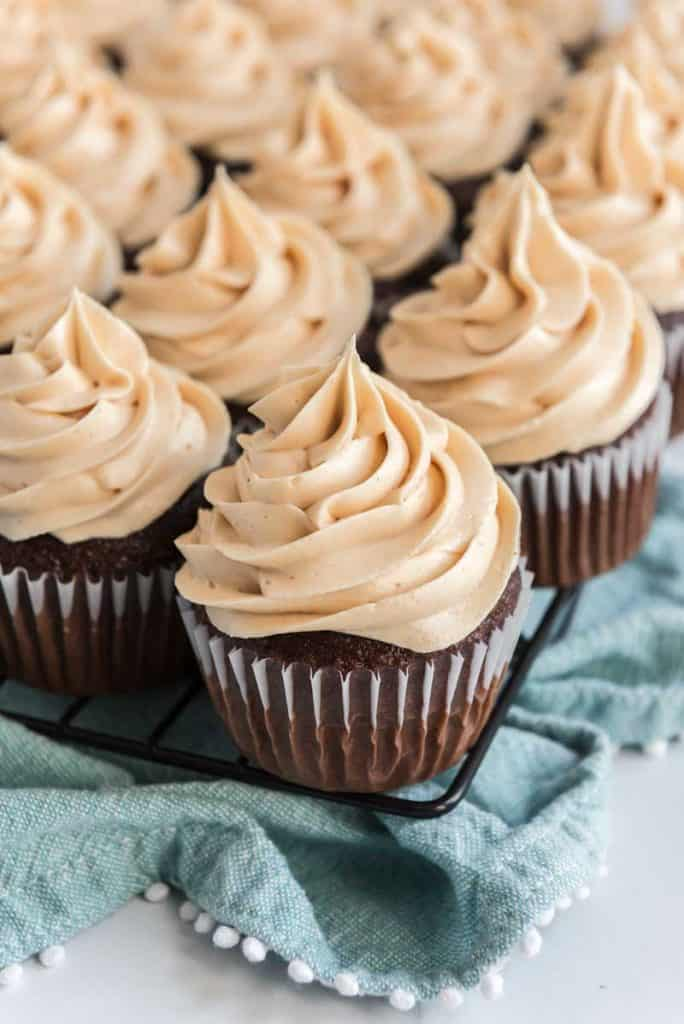 peanut butter buttercream frosting on chocolate cupcake