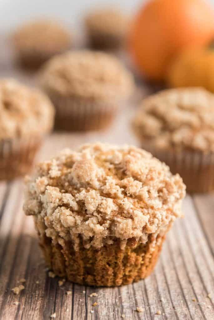 pumpkin muffins with crumble topping on wood board