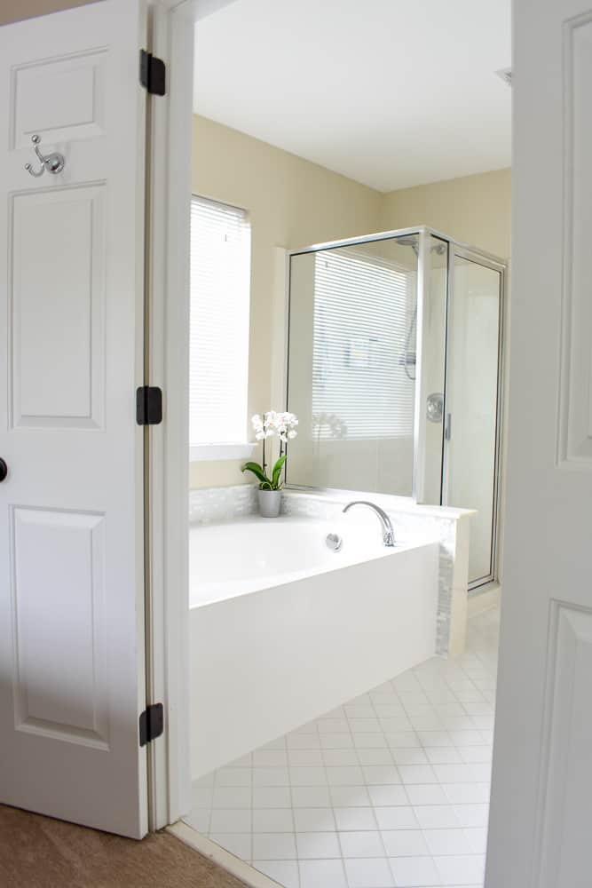 A large bathroom with a soaker tub and walk-in shower