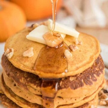 pumpkin pancakes with butter and syrup