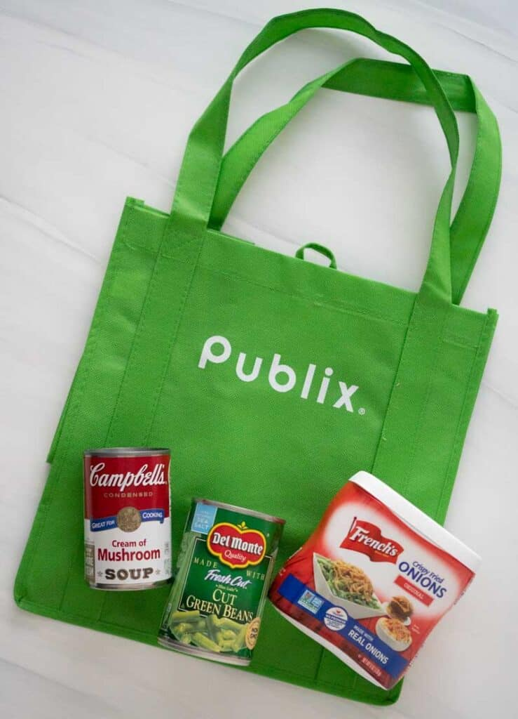 publix reusable shopping bag with campbells cream of mushrooms osoup, canned green beans amd frenchs crispy onions