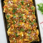 bbq pulled pork nachos on baking dish