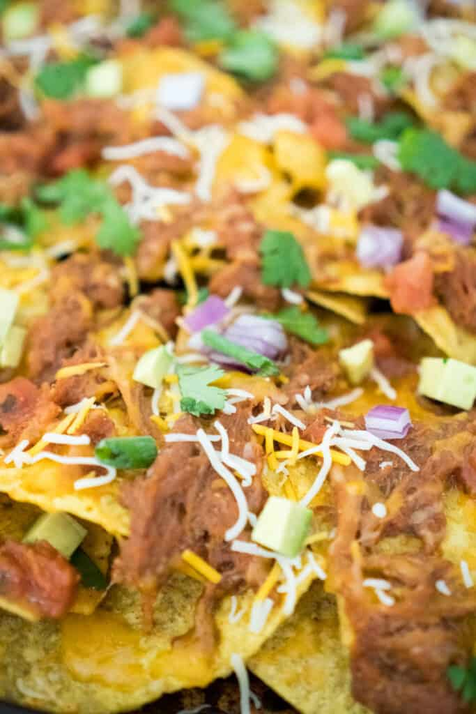 close up picture of pulled pork nachos