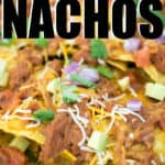 close up of pulled pork nachos with toppings