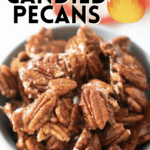 close up of spicy candied pecans in white bowl