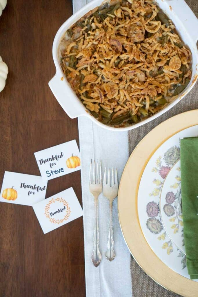 table setting with green bean casserole and thanksgiving place cards
