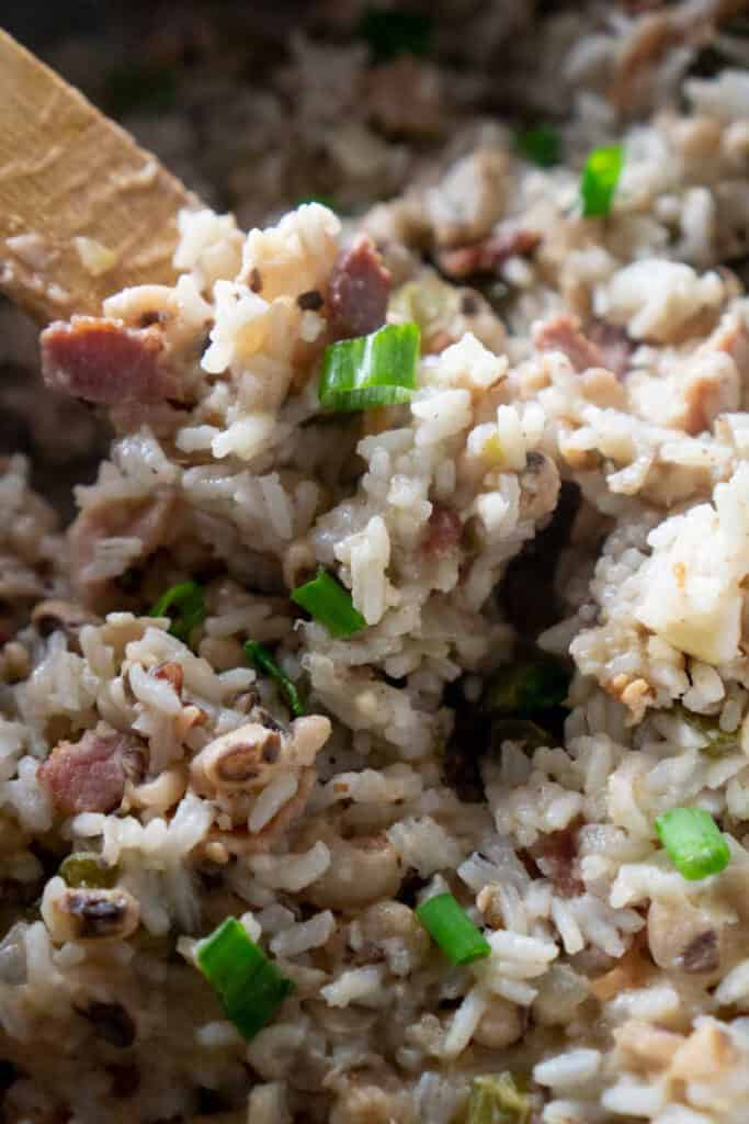 A close up of hoppin john with black eyed peas and rice in pan