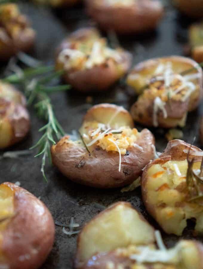 rosemary garlic smashed potatoes on baking sheet