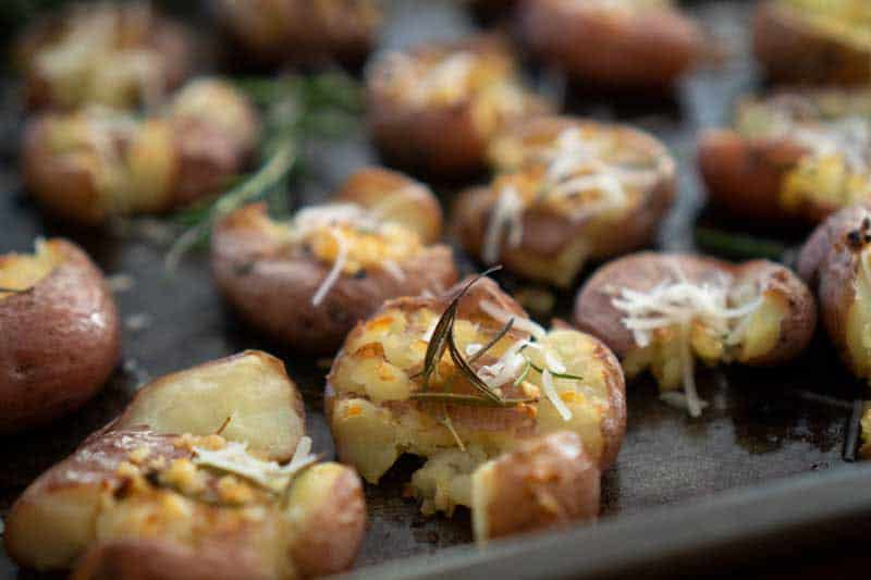 rosemary garlic smashed potatoes on baking sheet