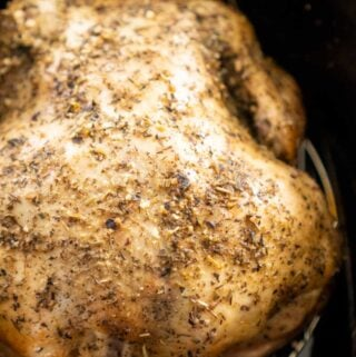 whole chicken with herbs in slow cooker