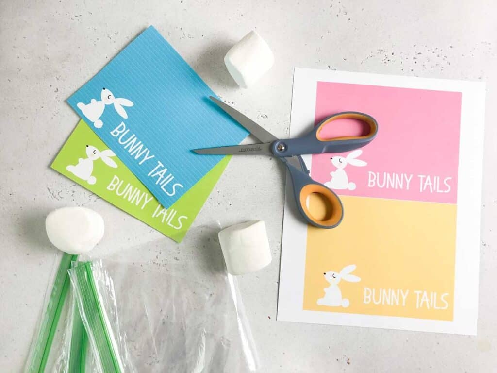 free printable easter bunny tail gift tags cut with scissors and marshmallows and sandwich bags