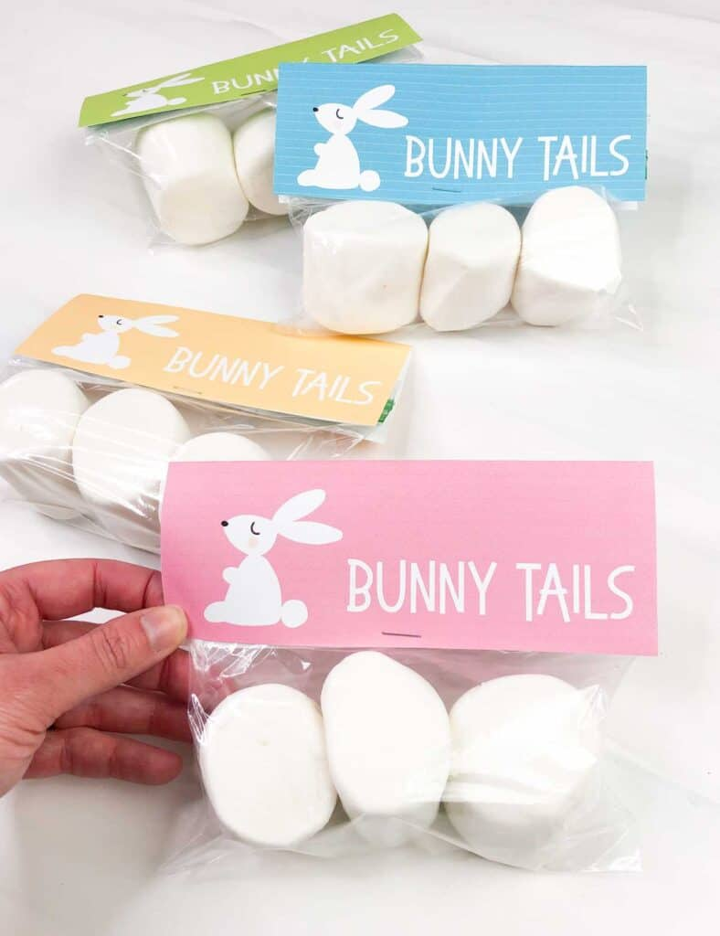 hand holding bag of large marshmallows with easter bunny tail free printable gift tag