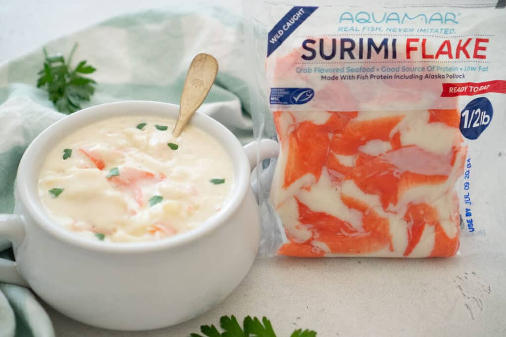 crab soup in white bowl with aquamar surimi