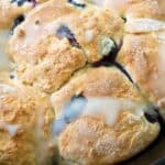 close up photo of blueberry buttermilk biscuits with lemon glaze