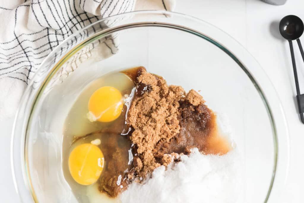 oatmeal raisin cookie ingredients in glass bowl