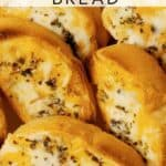 close up photo of slices of garlic bread with text overlay reading garlic bread