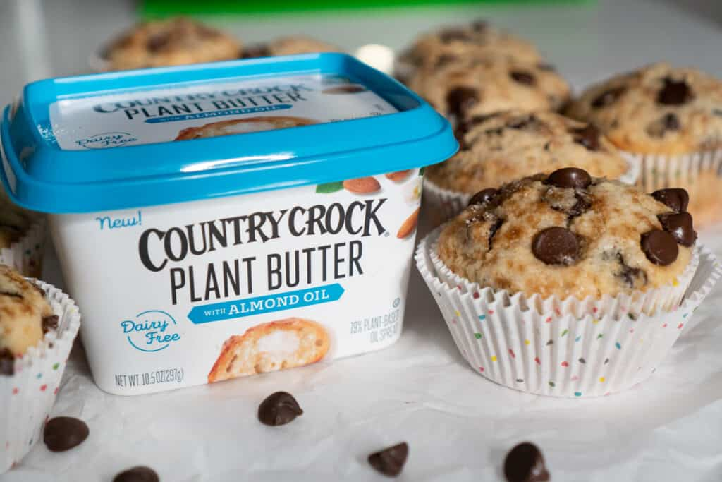 chocolate chip muffin next to Country Crock plant butter tub