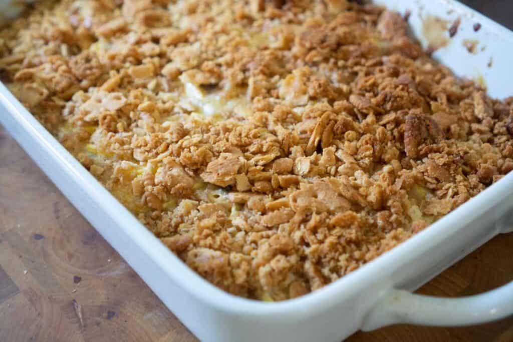 southern squash casserole in white dish
