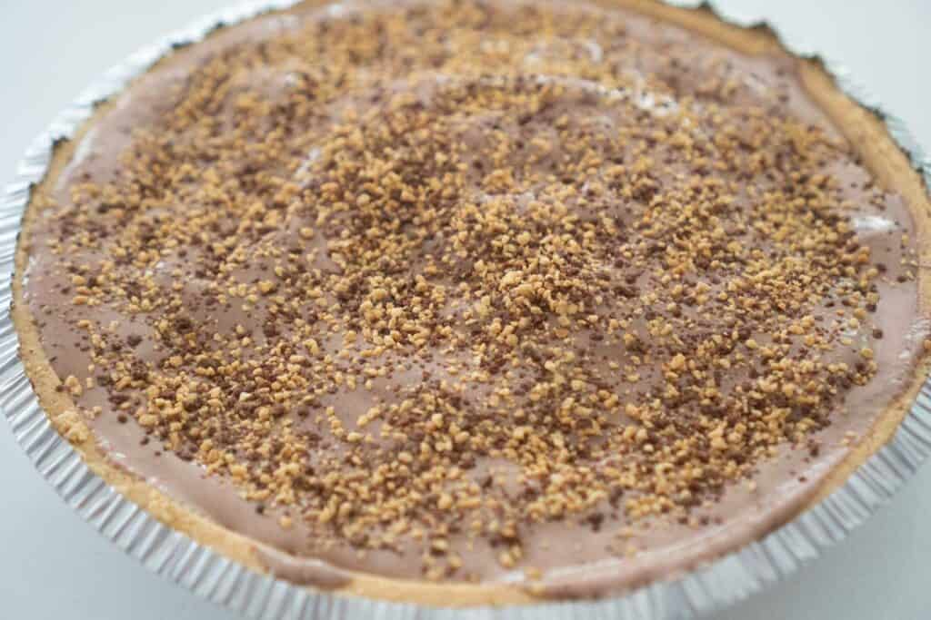 chocolate ice cream pie with toffee crumbles on top