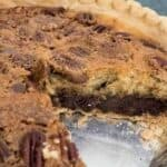 text reading kentucky derby pie over photo of pie with one slice missing