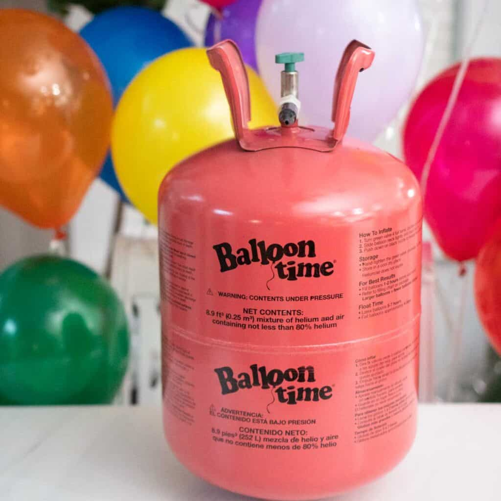 balloon time portable helium tank on table