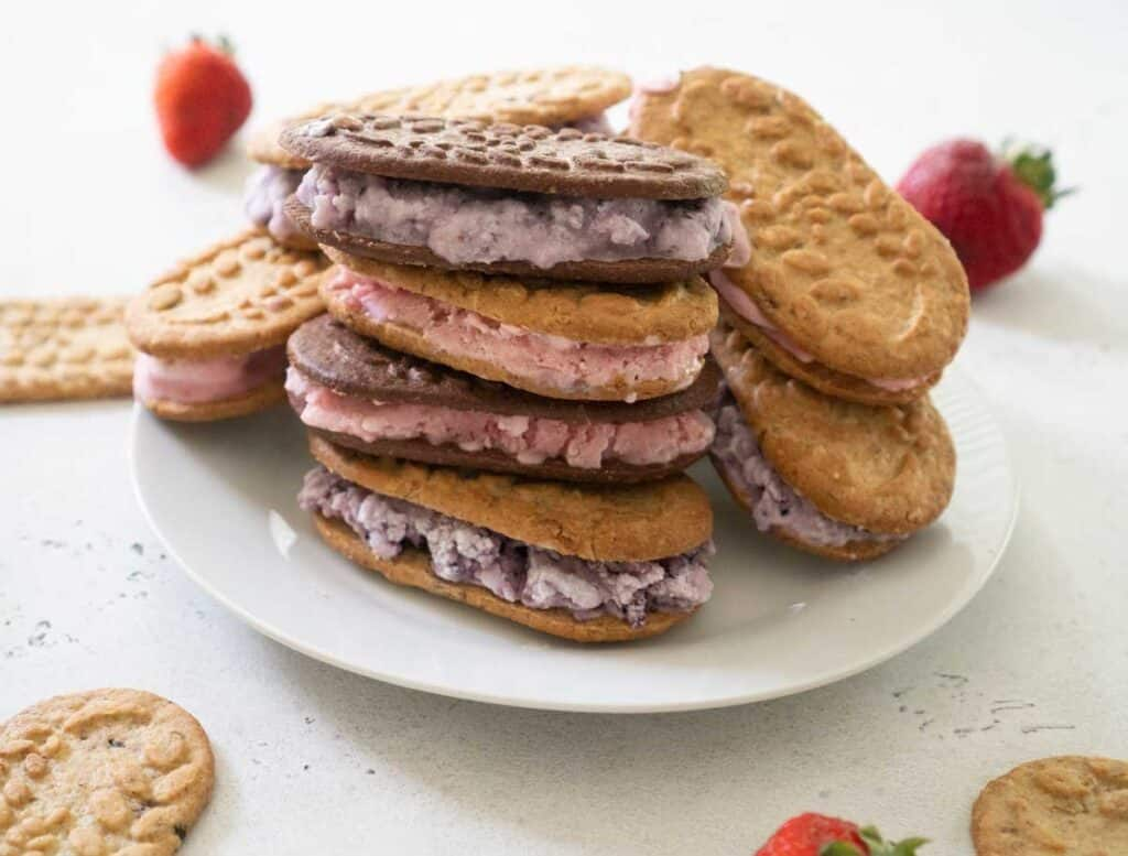 breakfast ice cream sandwiches stacked on white plate